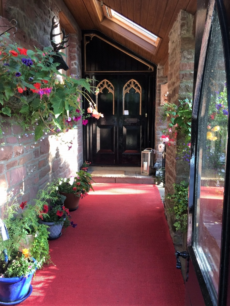 Flowers at entrance of Langtoft Manor, Bed and Breakfast